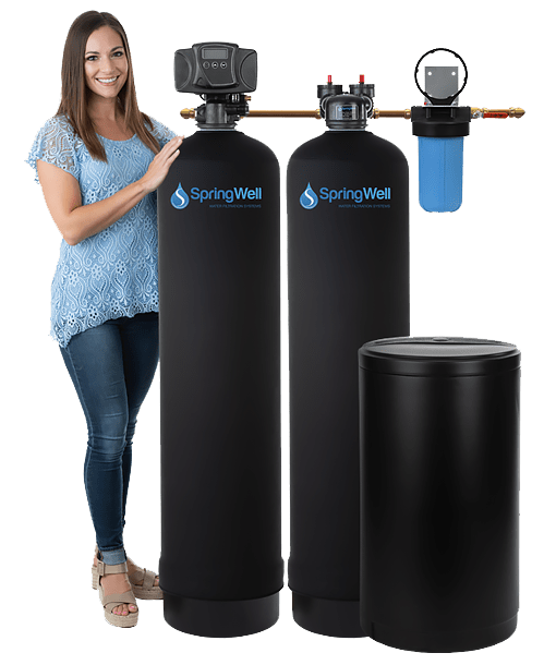 woman standing with a water system