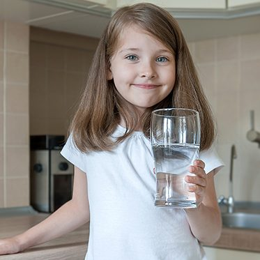 girl drinking ro water