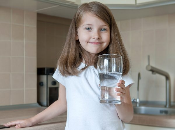 child drinking lead contaminated water
