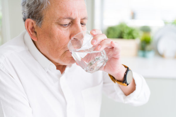 elderly man drinking water during covid19