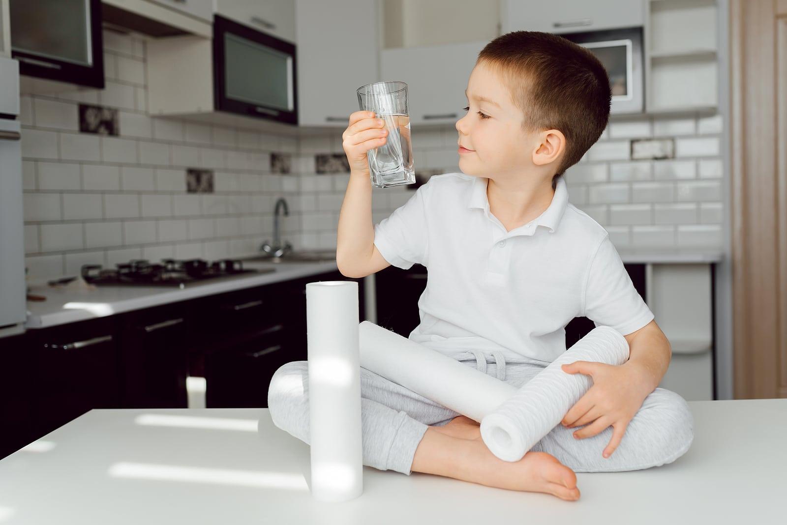 boy drinking purified water
